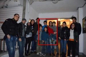 Евгения Попова и нейните деца със щедрите дарители пред блока